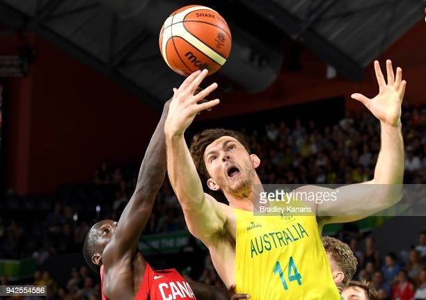 Angus Brandt of Australia and Munis Tutu of Canada compete for the ball during the Basketball match between Australia and Canada on day two of the...