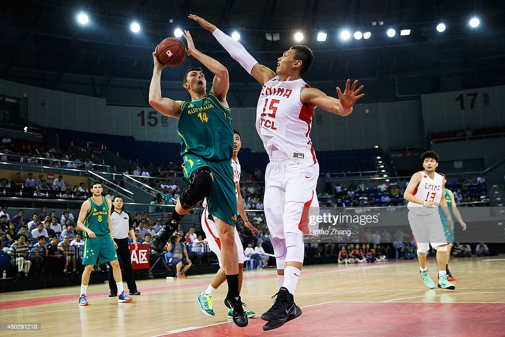 Angus Brandt (C) of Australia drives to the basket against Xu Zhonghao of China during the 2014 Sino-Australia Men's International Basketball Challenge match between the Australian Boomers and China at Liyang City Stadium on June 8, 2014 in Changzhou, China.