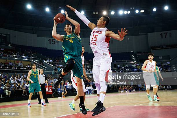 Angus Brandt of Australia drives to the basket against Xu Zhonghao of China during the 2014 SinoAustralia Men's International Basketball Challenge...