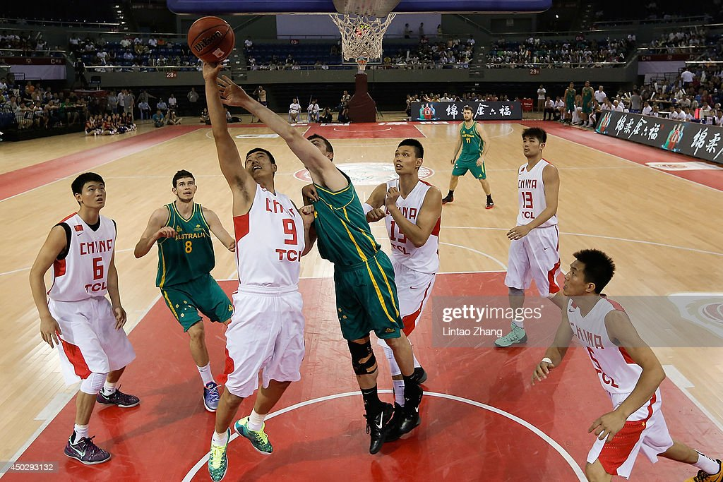 Angus Brandt (C) of Australia drives to the basket against Zhai Xiaochuan of China during the 2014 Sino-Australia Men's International Basketball Challenge match between the Australian Boomers and China at Liyang City Stadium on June 8, 2014 in Changzhou, China.