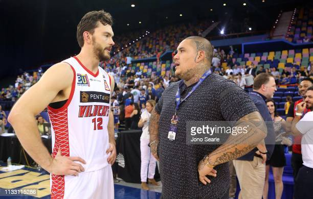 Angus Brandt of Perth talks with former NFL player Jesse Williams during game two of the NBL Semi Final Series between the Brisbane Bullets and the...
