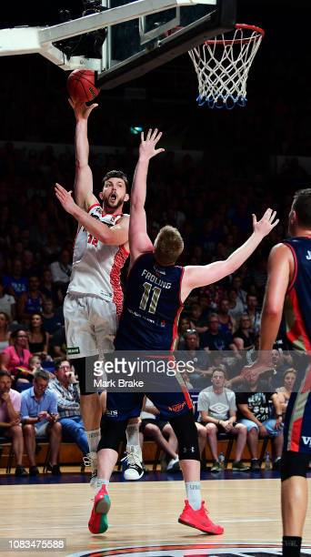 Angus Brandt of the Perth Wildcats shoots over Harry Froling of the Adelaide 36ers during the round 14 NBL match between the Adelaide 36ers and the...