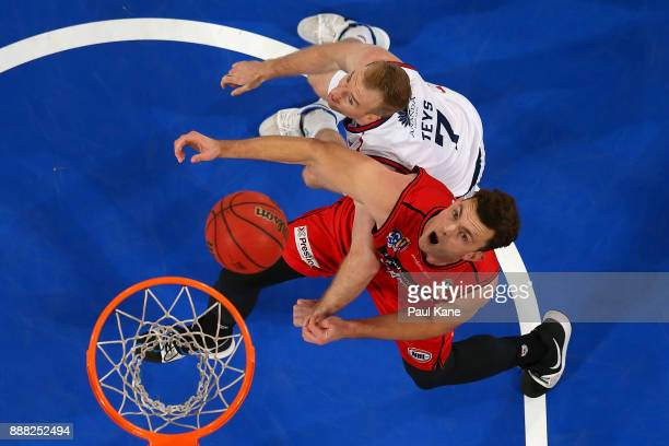 Angus Brandt of the Wildcats and Brendan Teys of the 36ers contest a rebound during the round nine NBL match between the Perth Wildcats and the...