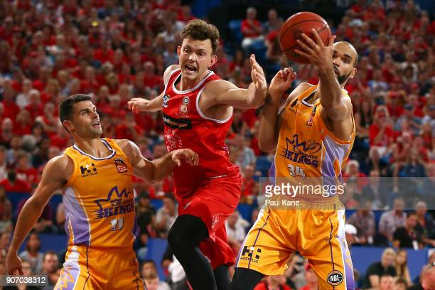 Angus Brandt of the Wildcats and Perry Ellis of the Kings contest a rebound during the round 15 NBL match between the Perth Wildcats and the Sydney...