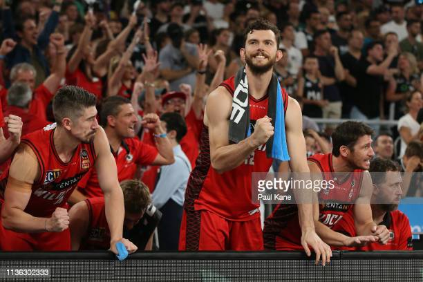 Angus Brandt of the Wildcats celebrates a basket from the bench during game 4 of the NBL Grand Final Series between Melbourne United and the Perth...