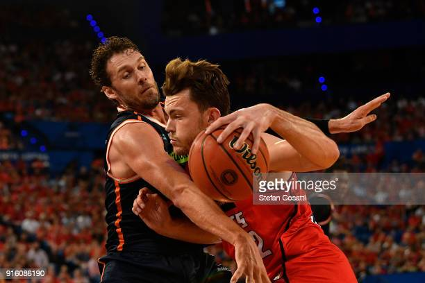 Angus Brandt of the Wildcats drives to the basket against Alex Loughton of the Taipans during the round 18 NBL match between the Perth Wildcats and...