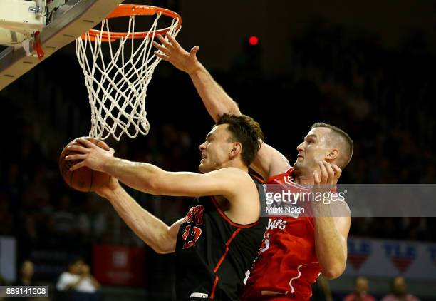 Angus Brandt of the Wildcats drives to the basket as Andrew Ogilvy of the Hawks defends during the round nine NBL match between the Illawarra Hawks...