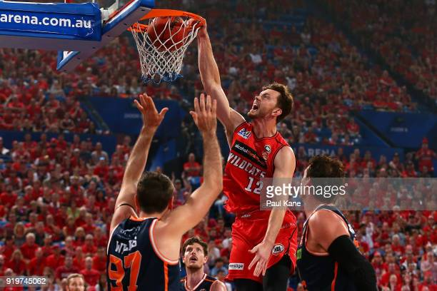 Angus Brandt of the Wildcats dunks the ball during the round 19 NBL match between the Perth Wildcats and the Cairns Taipans at Perth Arena on...