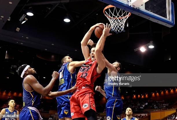 Angus Brandt of the Wildcats is pressured by the defence as he attempts a rebound during the round 14 NBL match between the Brisbane Bullets and the...