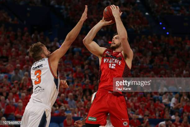 Angus Brandt of the Wildcats puts a shot up against Mitch Young of the Taipans during the round eight NBL match between the Perth Wildcats and the...