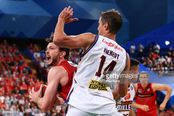 Angus Brandt of the Wildcats works to the basket against Daniel Kickert of the Bullets during the round 18 NBL match between the Perth Wildcats and...