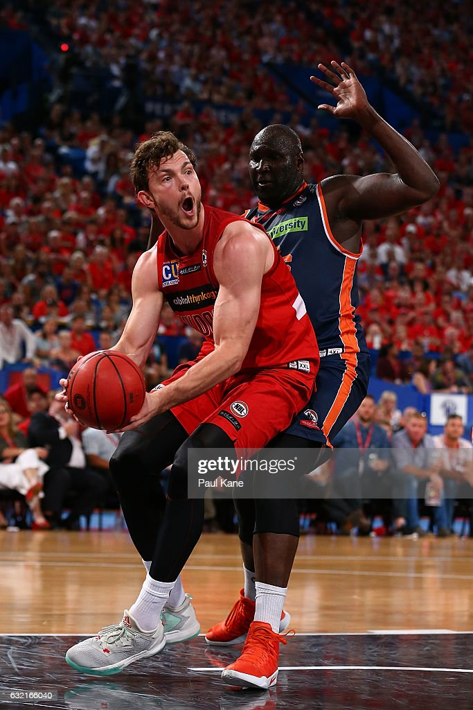 Angus Brandt of the Wildcats works to the basket against Nathan Jawai of the Taipans during the round 16 NBL match between the Perth Wildcats and the Cairns Taipans at Perth Arena on January 20, 2017 in Perth, Australia.