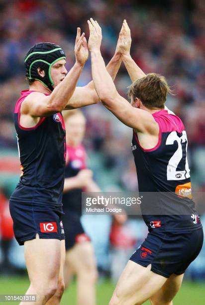 Angus Brayshaw Aaron Vandenberg of the Demons celebrate a goal during the round 21 AFL match between the Melbourne Demons and the Sydney Swans at...