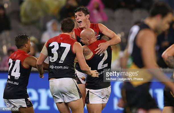Angus Brayshaw of the Demons celebrates a goal with teamates during the round four AFL match between the Richmond Tigers and the Melbourne Demons at...