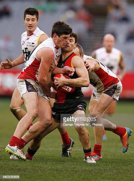 Angus Brayshaw of the Demons collides with Ben Howlett of the Bombers during the round 15 AFL match between the Essendon Bombers and the Melbourne...