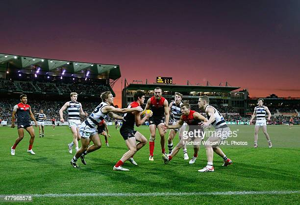 Angus Brayshaw of the Demons is tackled by Cory Gregson of the Cats during the 2015 AFL round twelve match between the Geelong Cats and the Melbourne...