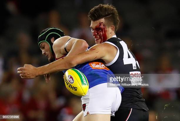 Angus Brayshaw of the Demons is tackled by Rowan Marshall of the Saints during the 2018 AFL round seven match between the St Kilda Saints and the...