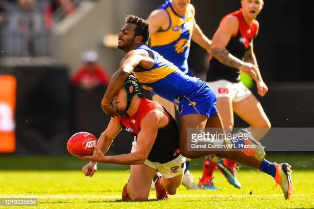 Angus Brayshaw of the Demons is tackled by Willie Rioli of the Eagles during the 2018 AFL round 22 match between the West Coast Eagles and the...