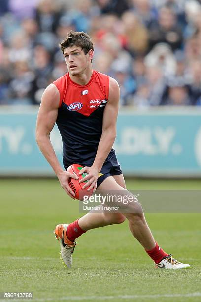 Angus Brayshaw of the Demons runs with the ball during the round 23 AFL match between the Geelong Cats and the Melbourne Demons at Simonds Stadium on...