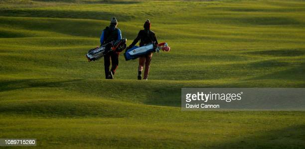 Angus Chilvers of St Benet's Hall College Oxford and Tito Bastienello of Merton College Oxford walk down the first fairway during the second day of...