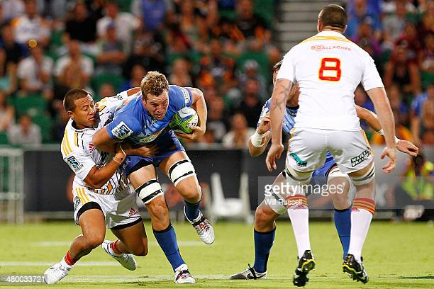 Angus Cotterell of the Force is tackled during the round six Super Rugby match between the Force and the Chiefs at nib Stadium on March 22 2014 in...