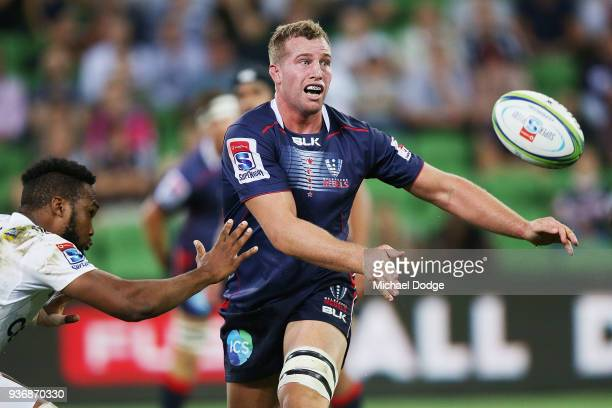 Angus Cottrell of the Rebels passes the ball during the round six Super Rugby match between the Melbourne Rebels and the Sharks at AAMI Park on March...