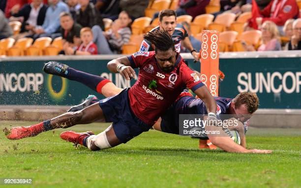 Angus Cottrell of the Rebels scores a try during the round 18 Super Rugby match between the Reds and the Rebels at Suncorp Stadium on July 6 2018 in...