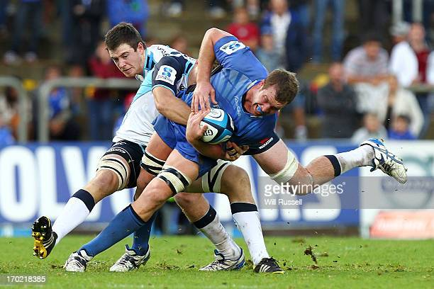 Angus Cottrell of the Western Force is tackled during the round 17 Super Rugby match between the Force and the Waratahs at nib Stadium on June 9,...