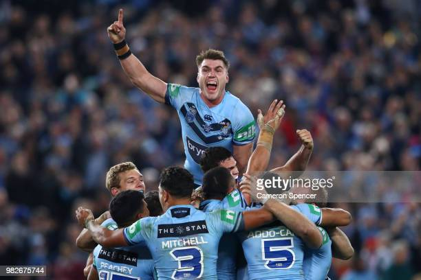 Angus Crichton of the Blues and team mates celebrate winning game two of the State of Origin series between the New South Wales Blues and the...