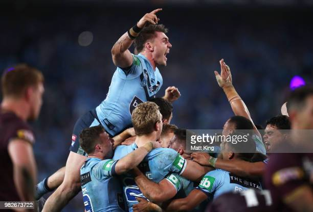 Angus Crichton of the Blues and team mates celebrates victory at the end of game two of the State of Origin series between the New South Wales Blues...