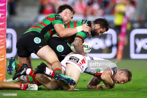 Angus Crichton of the Rabbitohs celebrates with Adam Reynolds of the Rabbitohs after he scored a try during the NRL Semi Final match between the...
