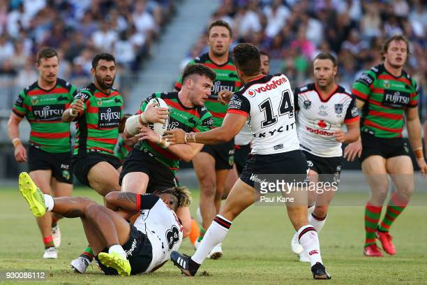 Angus Crichton of the Rabbitohs gets tackled by James Gavet of the Warriors during the round one NRL match between the South Sydney Rabbitohs and the...
