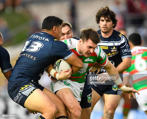 Angus Crichton of the Rabbitohs is tackled by Jason Taumalolo of the Cowboys during the round 11 NRL match between the North Queensland Cowboys and...