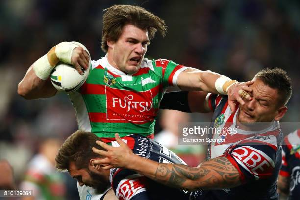 Angus Crichton of the Rabbitohs is tackled during the round 18 NRL match between the Sydney Roosters and the South Sydney Rabbitohs at Allianz...