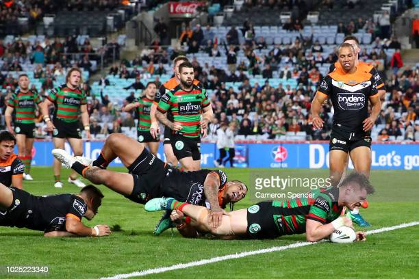 Angus Crichton of the Rabbitohs scores a try during the round 25 NRL match between the South Sydney Rabbitohs and the Wests Tigers at ANZ Stadium on...
