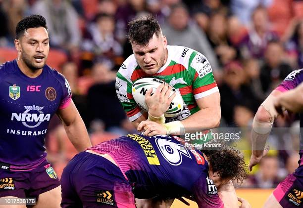 Angus Crichton of the Rabbitohs takes on the defence during the round 23 NRL match between the Brisbane Broncos and the South Sydney Rabbitohs at...