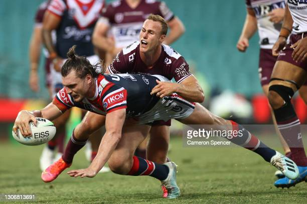 Angus Crichton of the Roosters is tackled Daly Cherry-Evans of the Sea Eagles as he scores a try during the round one NRL match between the Sydney...
