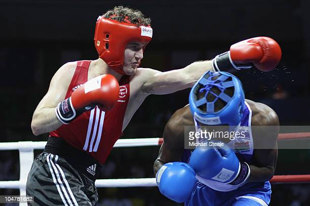 Angus Donaldson of New Zealand in action against Ensa Jammeh of Gambia in the Light 60kg category at the Talkatora Indoor Stadium during day two of...