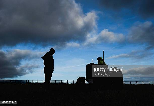 Angus Grey from Darlington drives his Massey Ferguson tractor as he takes part in the annual ploughing match on November 27, 2016 in Staithes, United...