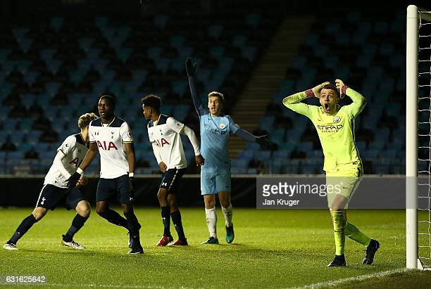 Angus Gunn of Manchester City looks on dejected after the equalizer by Shilow Tracey of Tottenham Hotspur during the Premier League 2 match between...