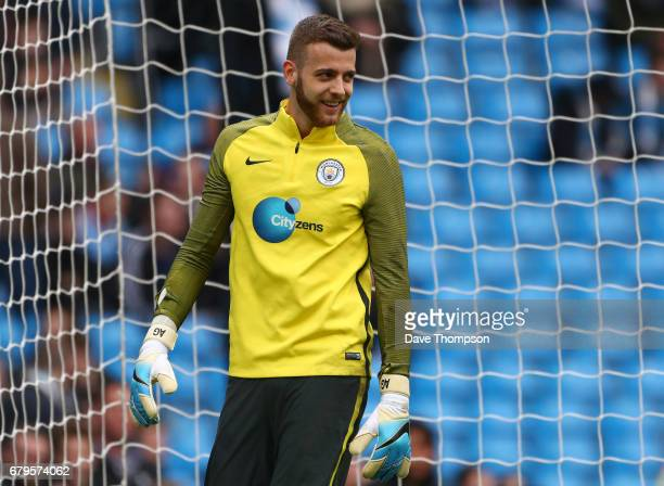 Angus Gunn of Manchester City warms up prior to the Premier League match between Manchester City and Crystal Palace at the Etihad Stadium on May 6...