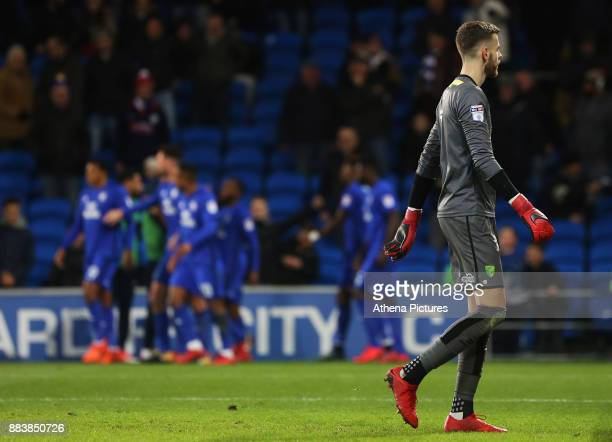 Angus Gunn of Norwich City looks on as Junior Hoilett of Cardiff City celebrates scoring his sides second goal of the match during the Sky Bet...