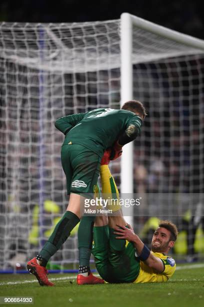 Angus Gunn of Norwich treats team mate Ivo Pinto for cramp during The Emirates FA Cup Third Round Replay between Chelsea and Norwich City at Stamford...