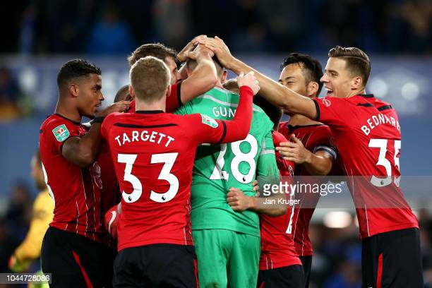 Angus Gunn of Southampton celebrates with his teammates as Southampton win the penalty shoot out during the Carabao Cup Third Round match between...