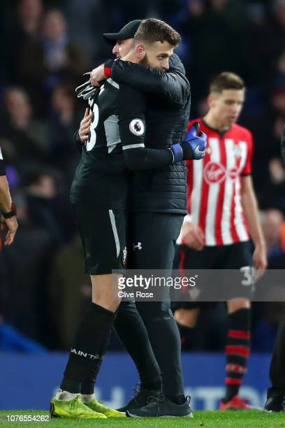 Angus Gunn of Southampton is embraces by Ralph Hasenhuettl Manager of Southampton after the Premier League match between Chelsea FC and Southampton...
