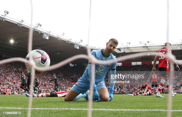 Angus Gunn of Southampton looks dejected after Roberto Firmino of Liverpool scored his team's second goal during the Premier League match between...