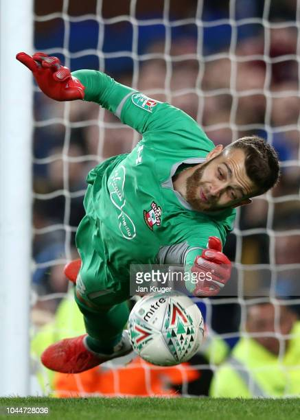 Angus Gunn of Southampton saves a penalty from Theo Walcott of Everton during a penalty shoot out during the Carabao Cup Third Round match between...