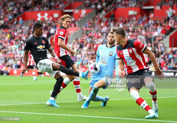 Angus Gunn of Southampton saves from Marcus Rashford of Manchester United during the Premier League match between Southampton FC and Manchester...