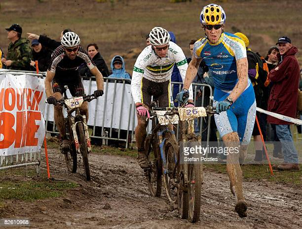 Angus Harding of Australia leads Daniel McConnell of Australia and Andrew Blair of Australia in the CrossCountry short coarse event during day two of...