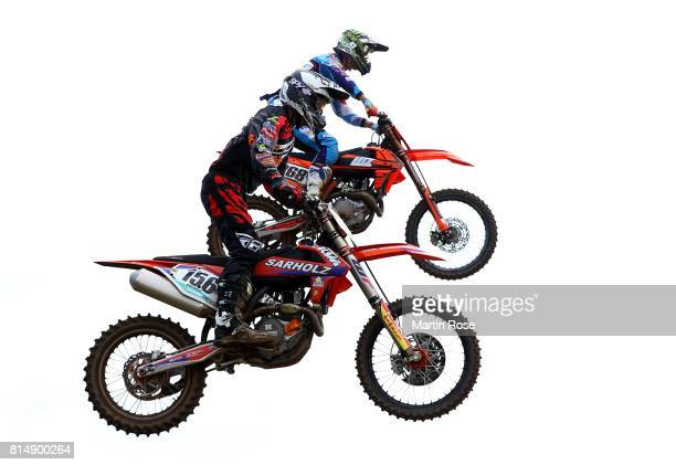 Angus Heidecke of Germany and Lukasz Lonka of Poland in action during the International German Motocross Championships on July 15 2017 in Tensfeld...
